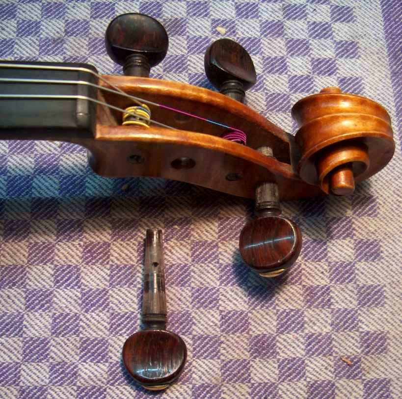 lubrification of pegs of violin.